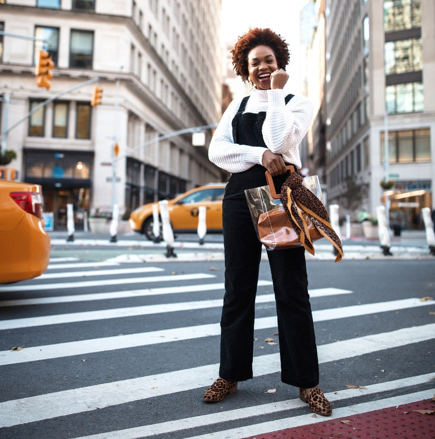 Ijeoma Kola wearing overalls and a chunky sweater