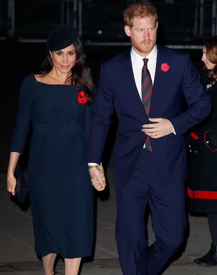 Meghan Markle Prince Harry wearing matching blue outfits.l