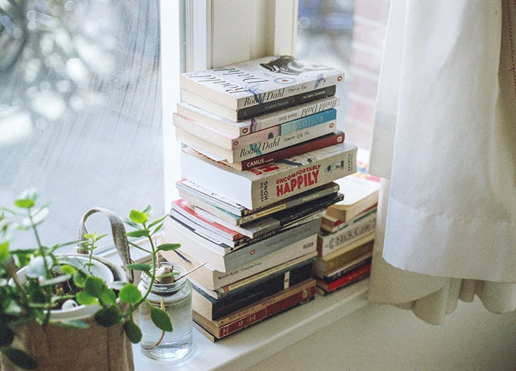 books sitting on window