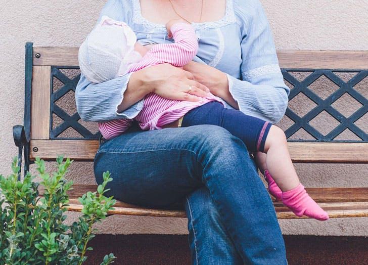 breastfeeding outside woman