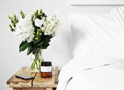 flowers on nightstand cat