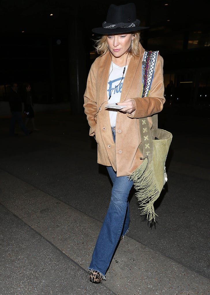 kate hudson wearing a graphic tee jeans and blazer