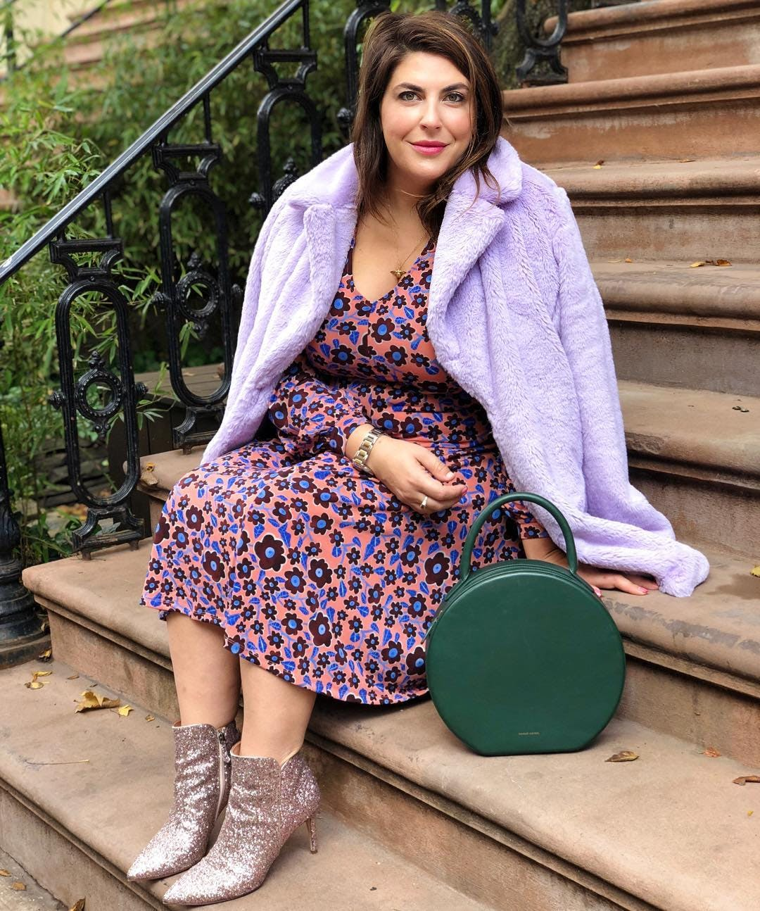 katie sturino wearing a floral dress and faux fur coat