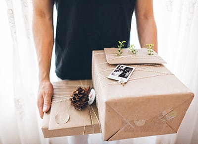 man holding gifts 400