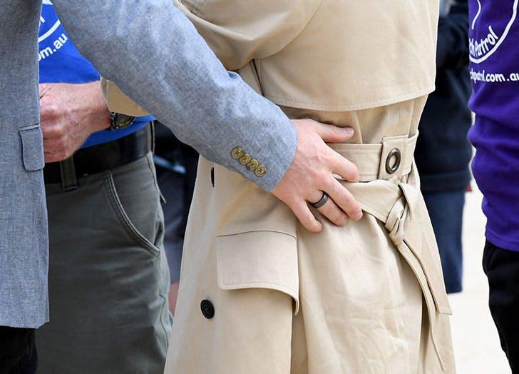 meghan markle prince harry hand on back