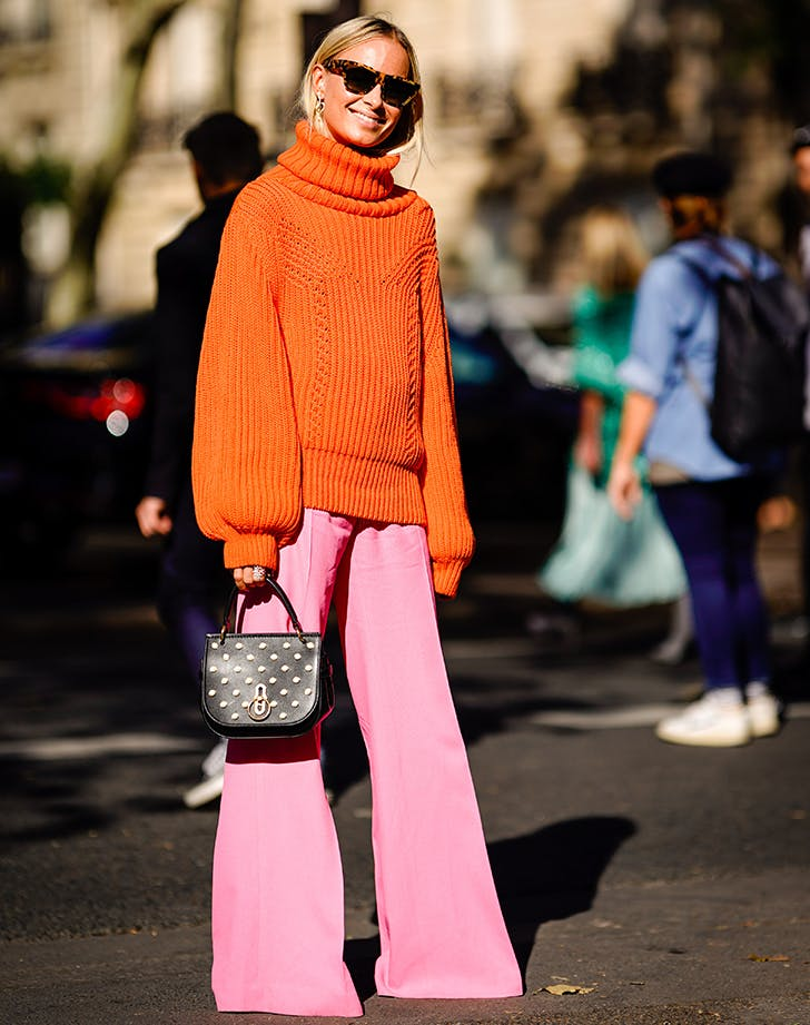 orange sweater and pink flares