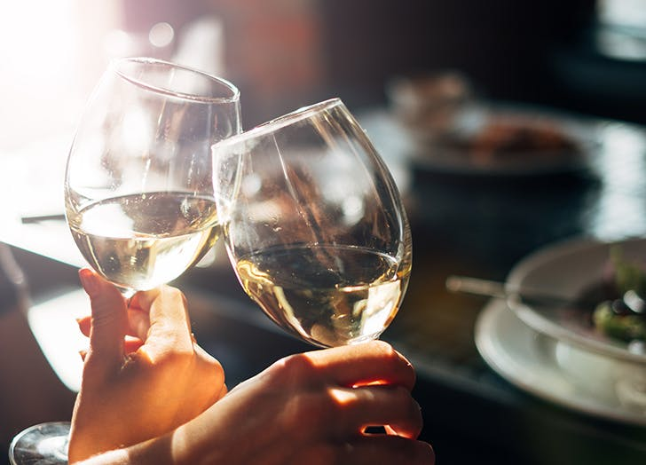 toasting with white wine at thanksgiving