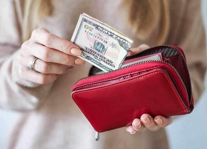 woman cash in wallet