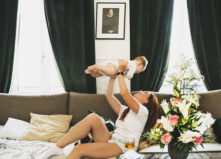 woman in hotel with baby
