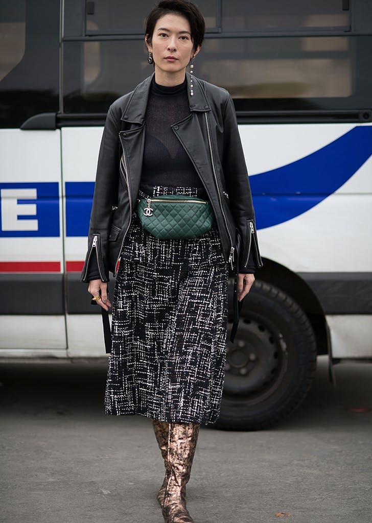 woman wearing a midi skirt and moto jacket
