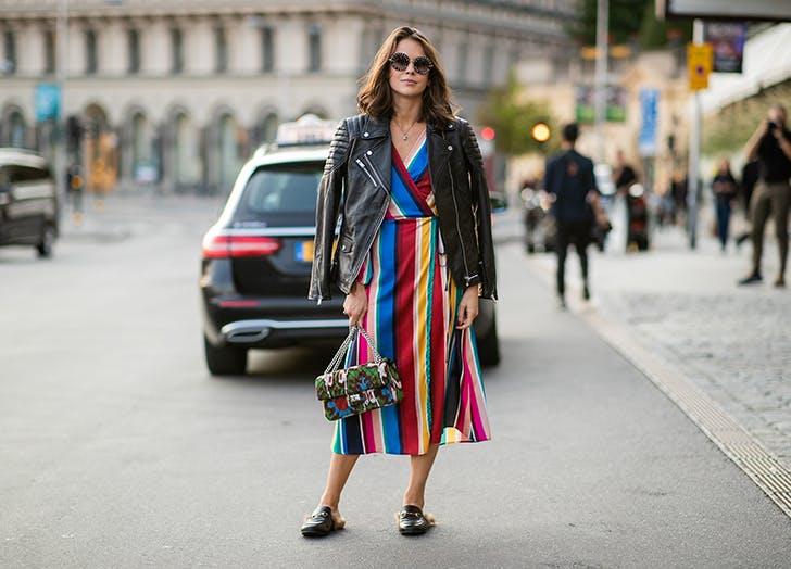 woman wearing a rainbow dress and moto jacket