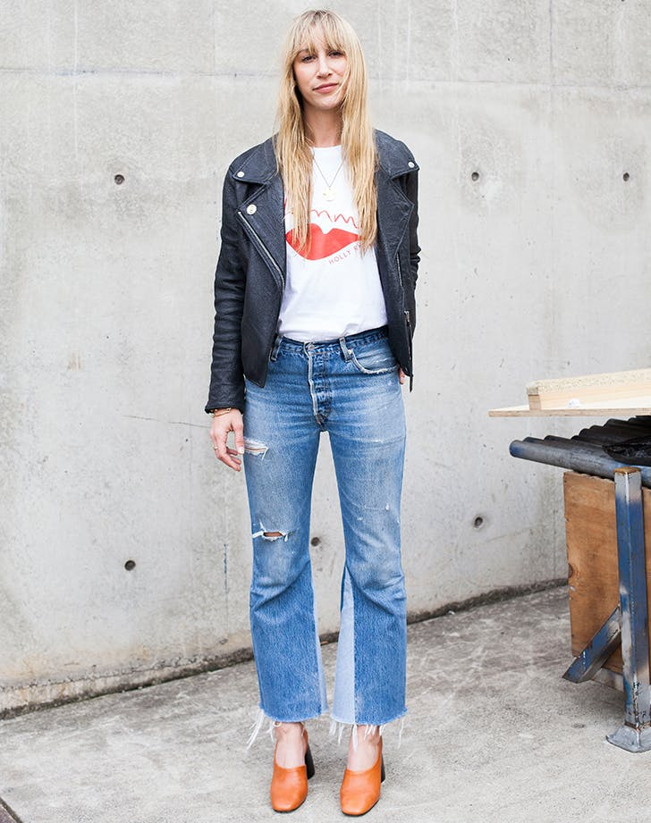 woman wearing jeans a tshirt and moto jacket