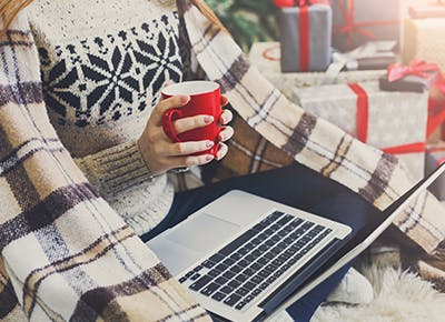 woman holding coffee and online shopping 4001