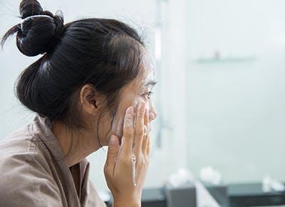woman washing face 400