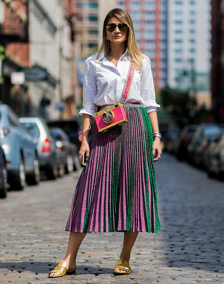 woman wearing a knit pleated skirt
