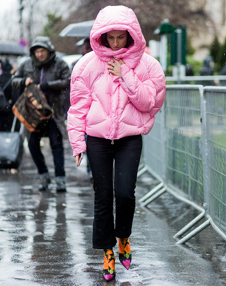 woman wearing a pink puffer coat