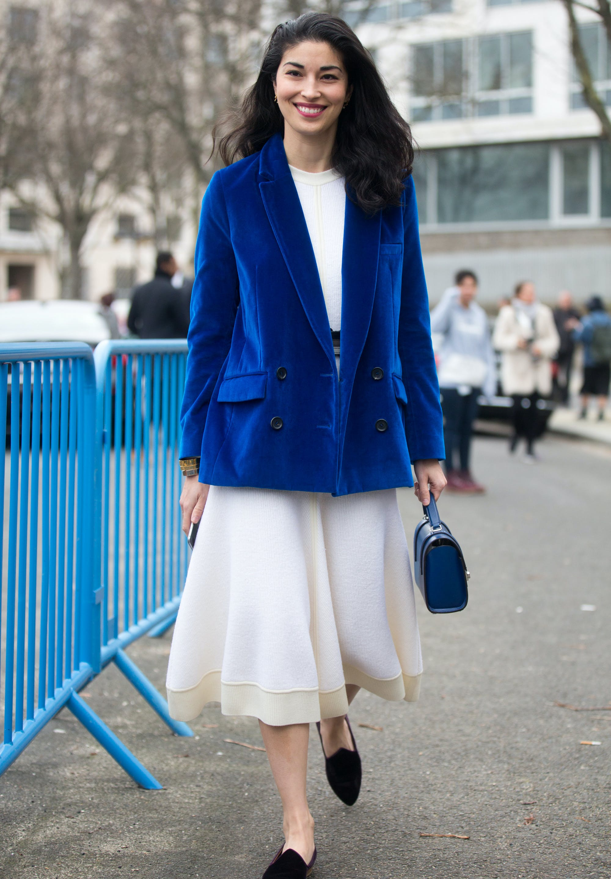 woman wearing a velvet blazer and tulle skirt