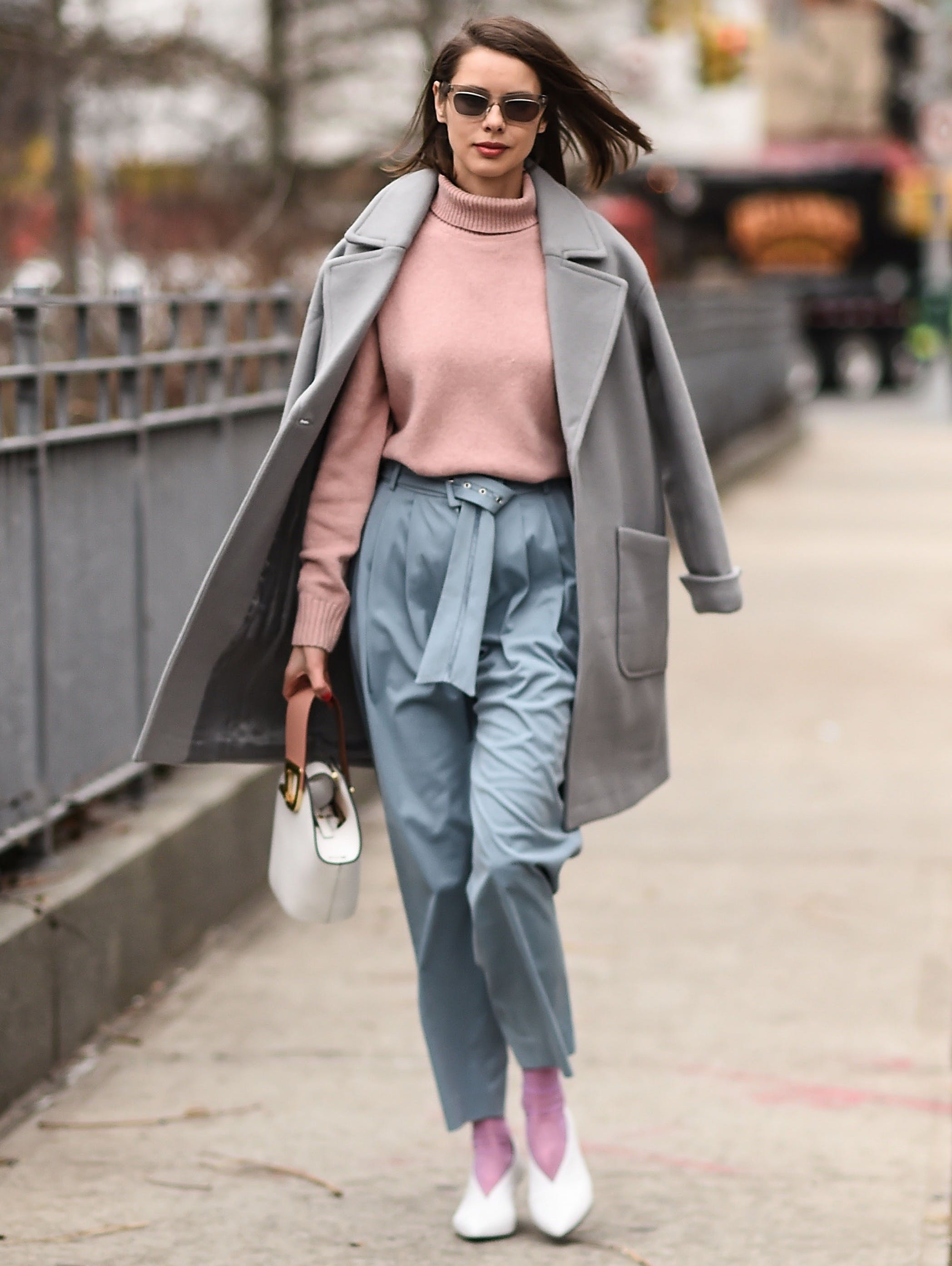 woman wearing gray and pastels