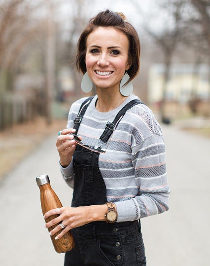 woman wearing leather earrings