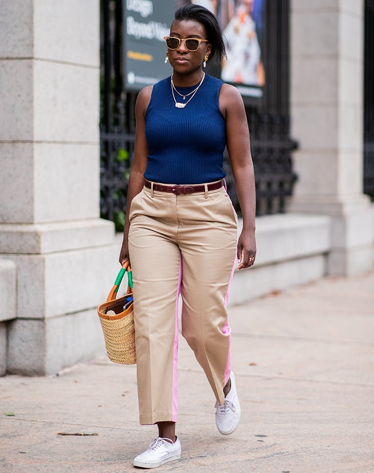woman wearing navy and beige