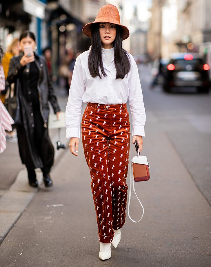 woman wearing printed corduroy pants