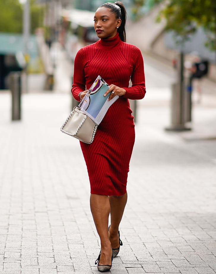 woman wearing red sweater dress