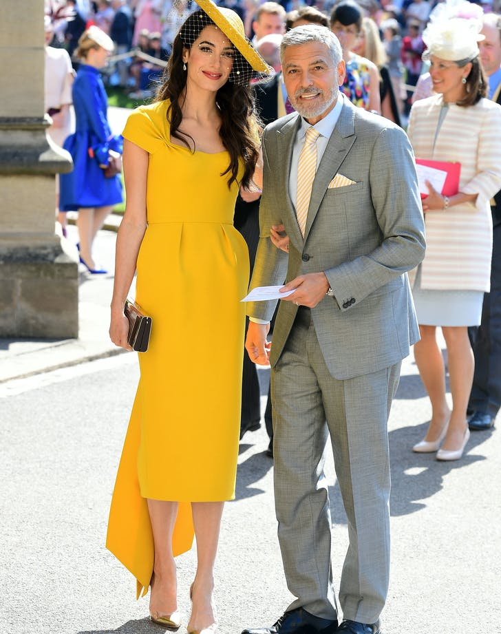 Amal and George Clooney at royal wedding.l