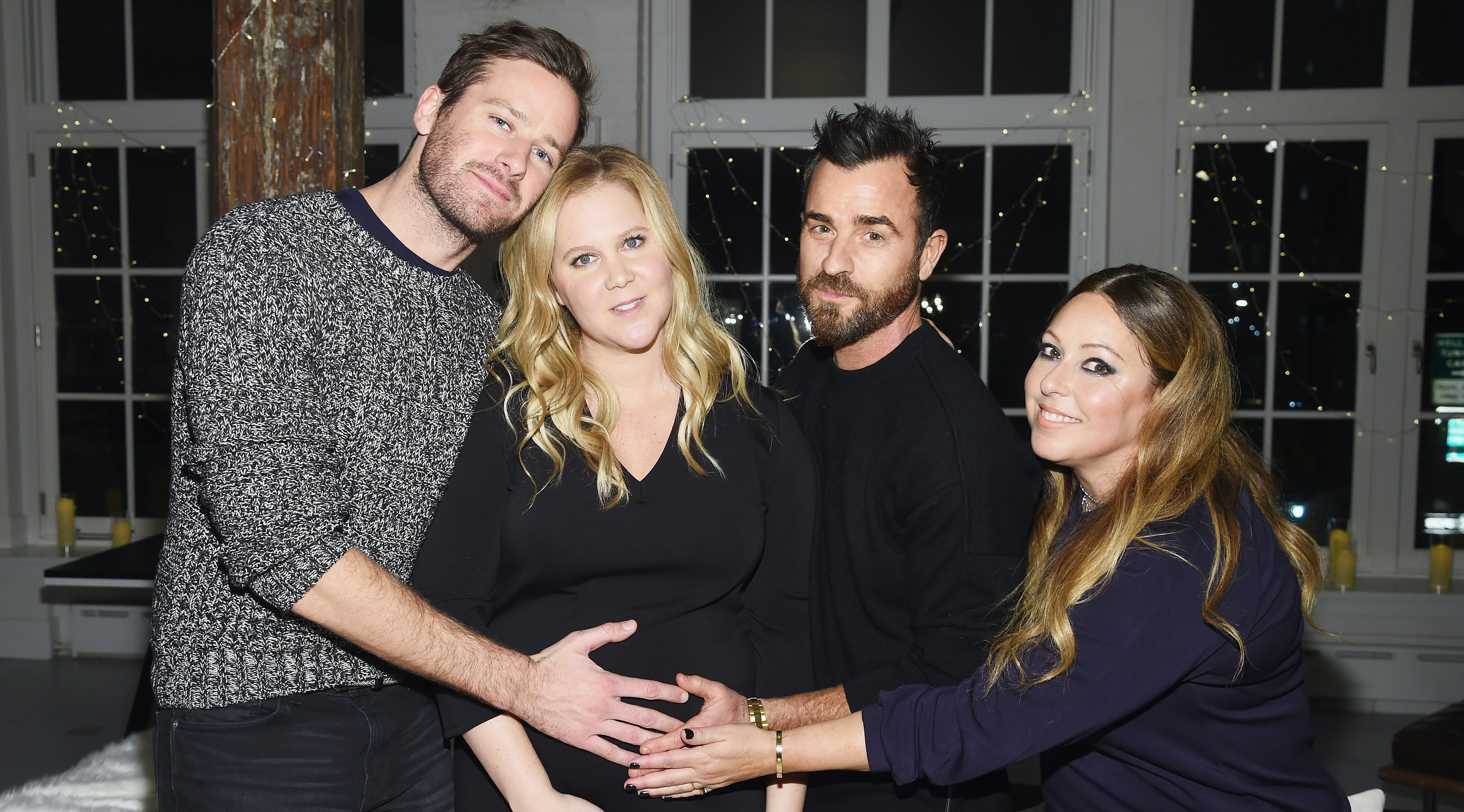 Armie Hammer & Justin Theroux Just Cradled Amy Schumer's Baby Bump and Hey, We Wouldn't Mind That