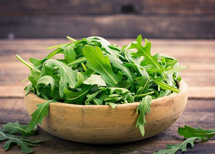 Arugula lettuce leaves in bowl