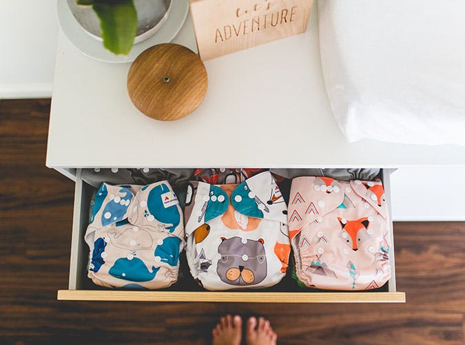 Baby clothes in drawer