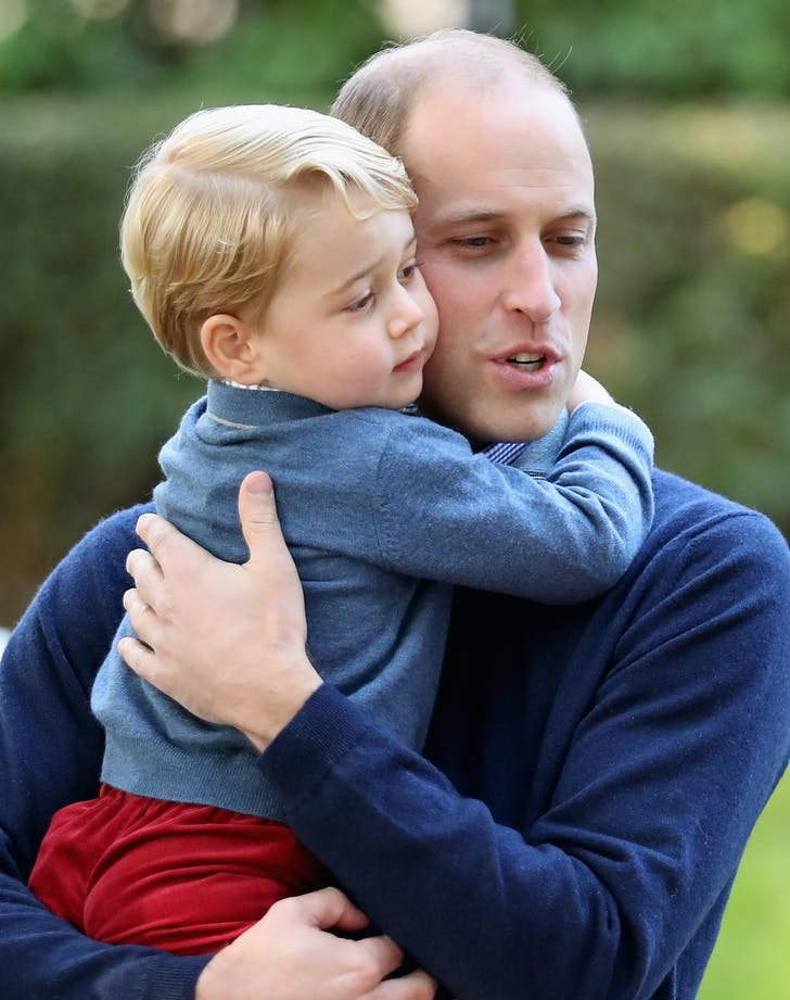 Prince William cuddling Prince George