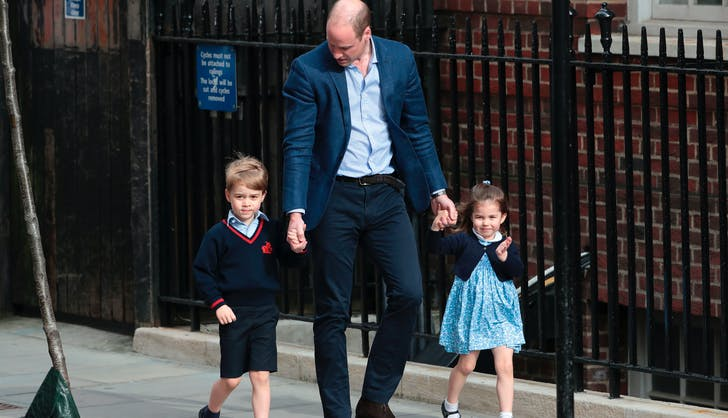 Prince William walking with his children