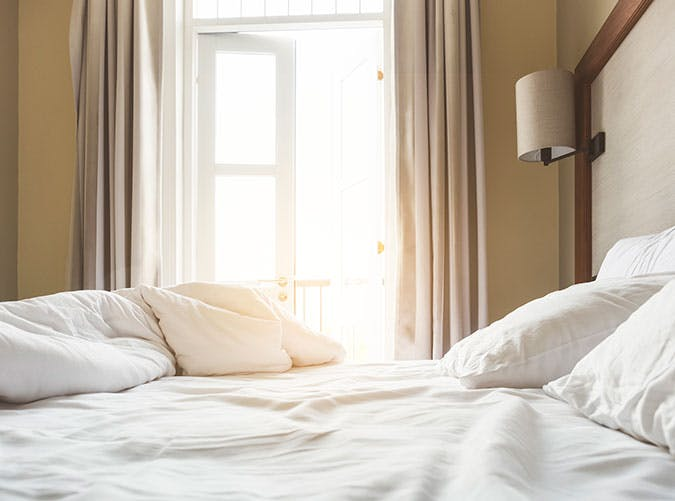 White unmade bed