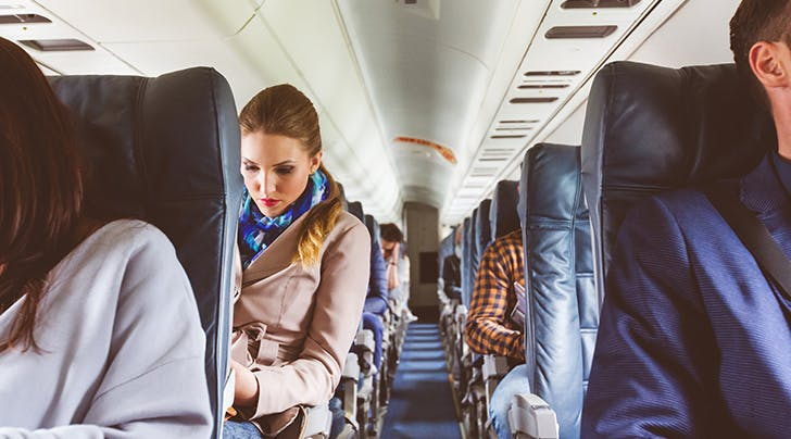 Stuck Flying in the Middle Seat? Heres How You Can Score Major Rewards for Your Traveling Woes