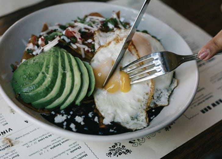 bowl eggs fork avocado