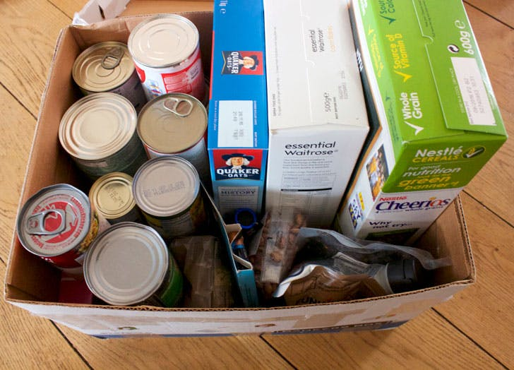 box of canned food and cereal