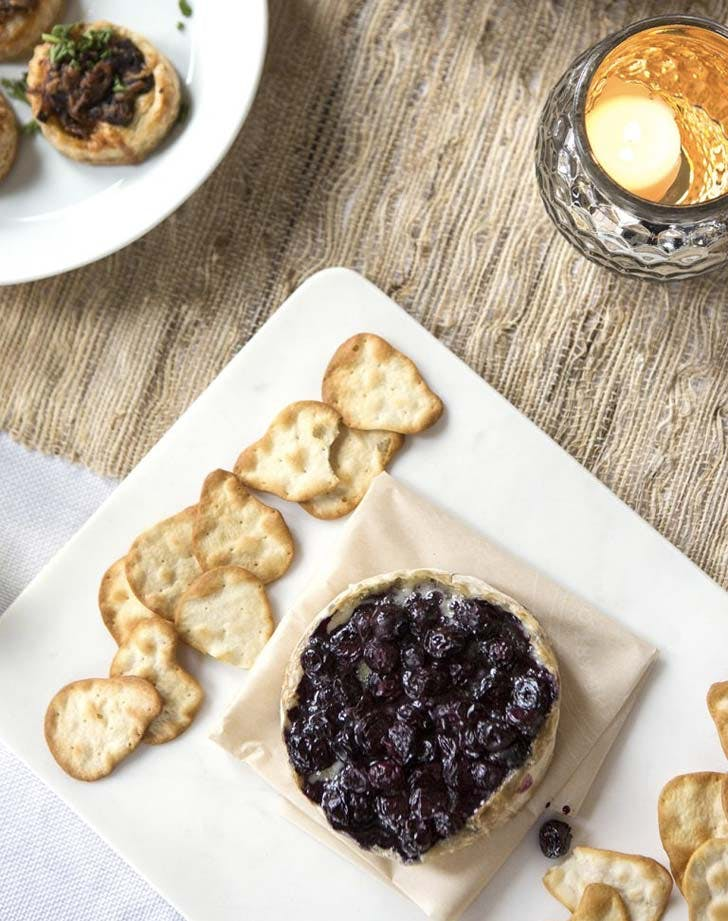 brie with wine soaked blueberries