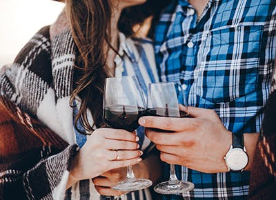 man and woman wearing flannel holding red wine recipe 290