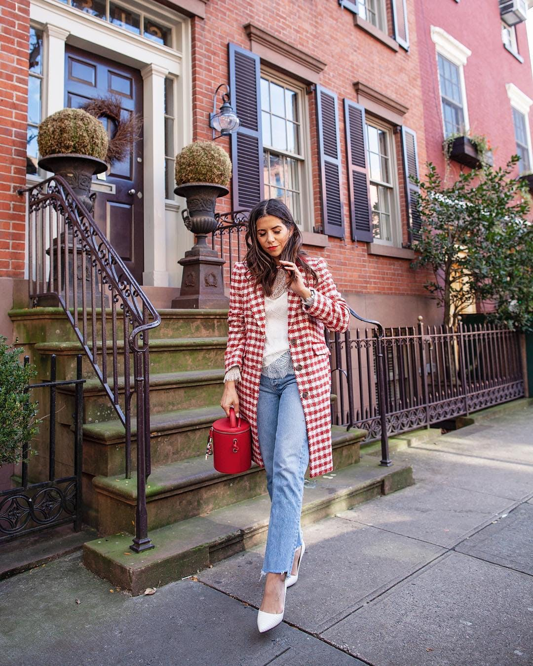 olivia jeanette wearing a red gingham coat