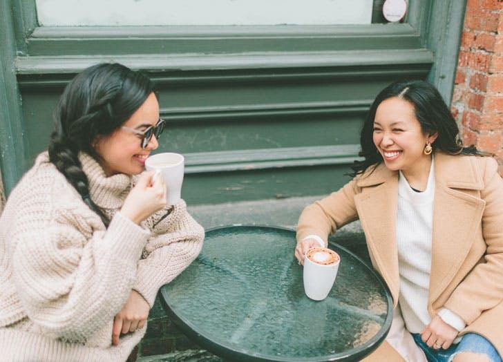 two women getting coffee