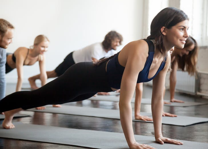 woman attending a group yoga class
