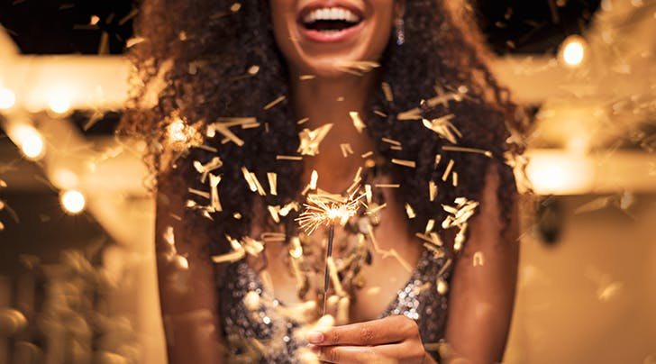 woman celebrating new years with a sparkler