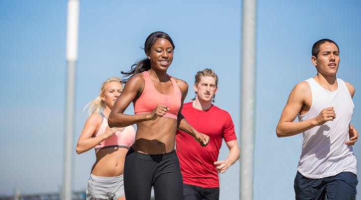 woman running in a sports bra