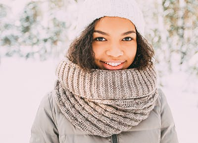 woman smiling in beanie and scarf 4001