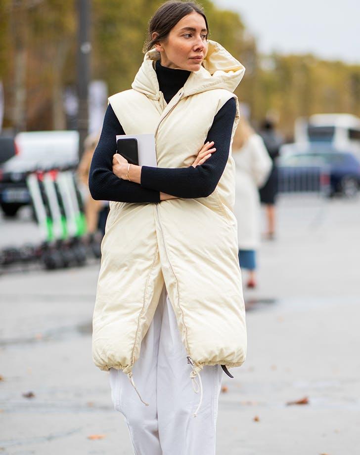 woman wearing a long puffer vest