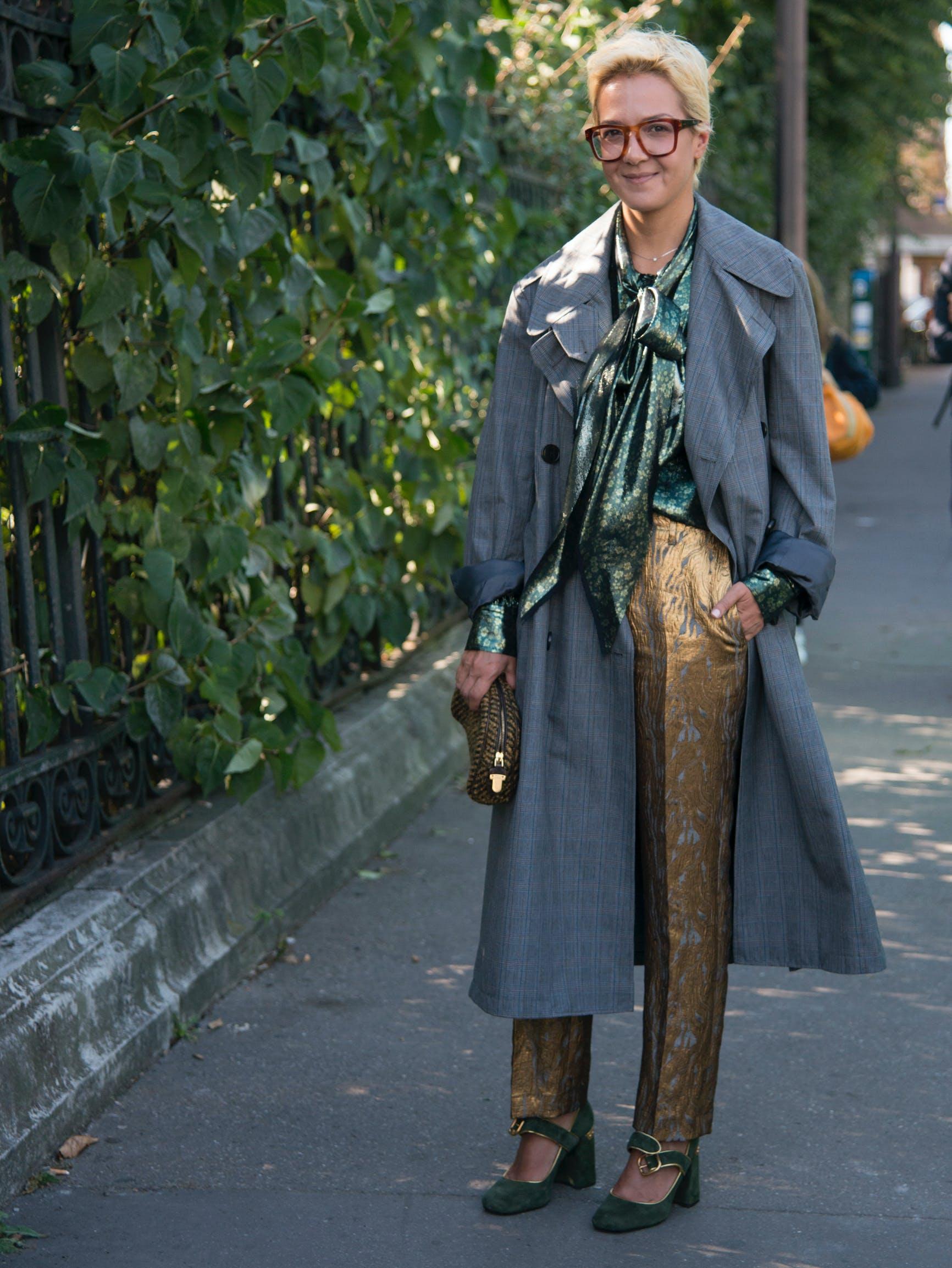 woman wearing a silk top and metallic pants
