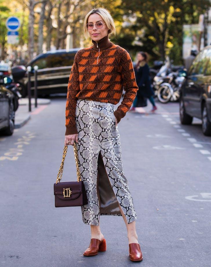 woman wearing a snake print midi skirt