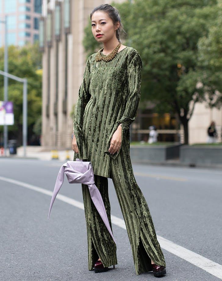 woman wearing a velvet matching set