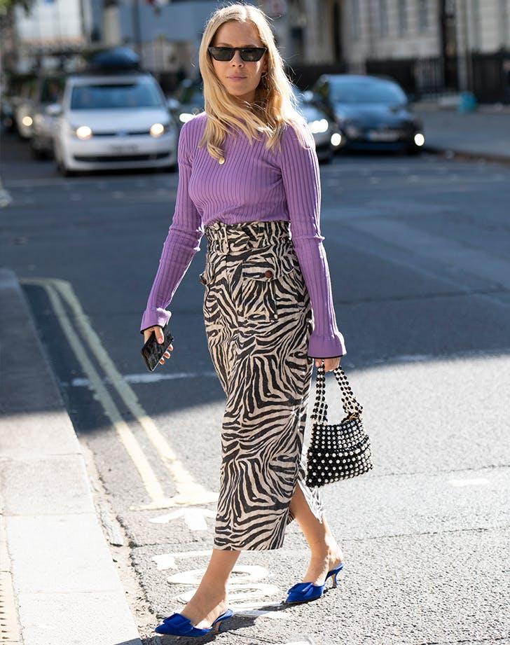 woman wearing a zebra print skirt