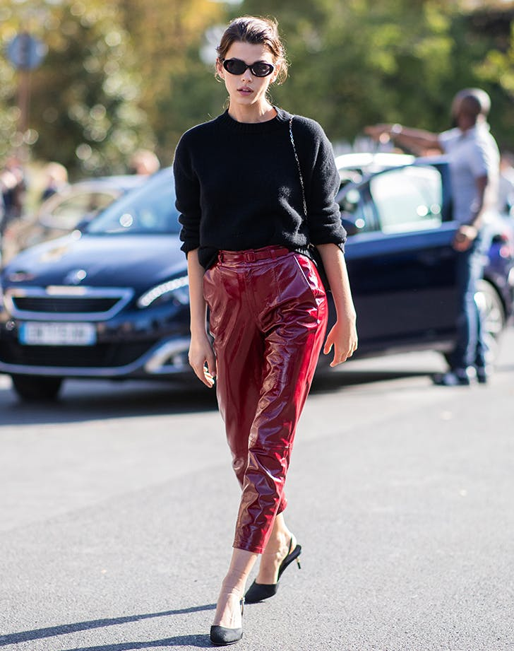 woman wearing red patent leather pants